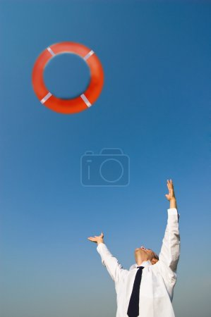 Photo for A businessman and life preserver - Royalty Free Image