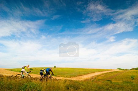 Photo for Mixed group of cyclists relax biking outdoors - Royalty Free Image