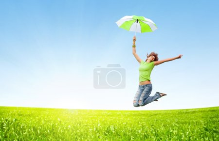 Photo for Young girl jumping with umbrellas - Royalty Free Image