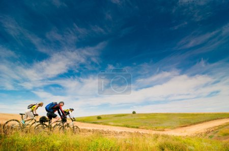 Cyclists relax biking outdoors
