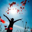 Girl stands in poppy field...