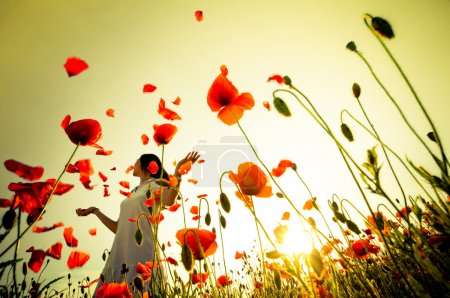 Photo for Girl stands in poppy field - Royalty Free Image