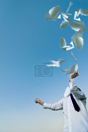 Photo for Businessman throws up his papers - Royalty Free Image