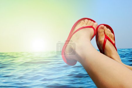 Photo for Women legs with red sandals - Royalty Free Image