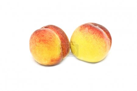 Two isolated peaches