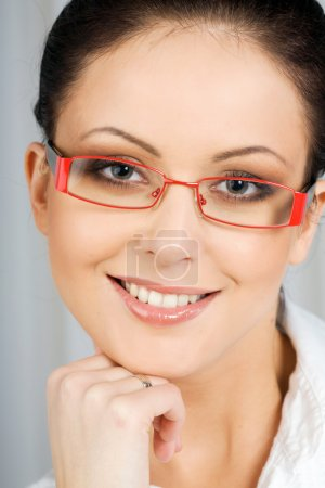 Face of smiling woman wearing sunglasses