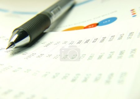 Photo for Finances statement and charts with pen background - Royalty Free Image