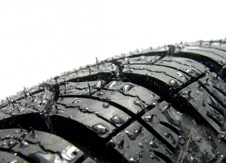 Photo for Car tyre in water drops - Royalty Free Image