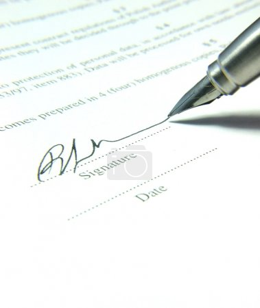 Photo for Fountain pen and signature on the contract - Royalty Free Image