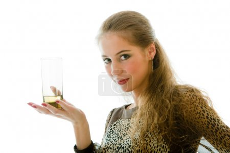The young beautiful woman with a juice glass