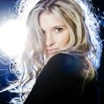 Dynamic portrait of a beautiful woman in a night c...