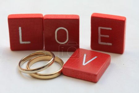 Photo for Love letters and wedding bands - Royalty Free Image
