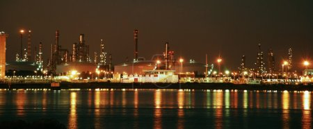Factory big refinery in night.