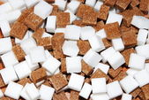 White and brown cubes of sugar
