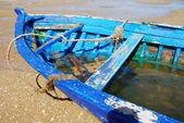 Old hull fishing blue boat