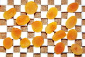 Cubes of sugar and dry apricots