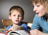 Mother teach son to read