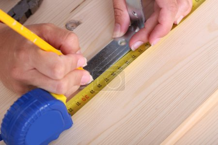 Wooden plank and measuring tape