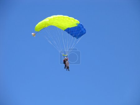 Parachutists in the blue sky