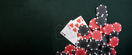 Photo for Casino chips on a green background and texas holdem poker cards. Vegas concept - Royalty Free Image