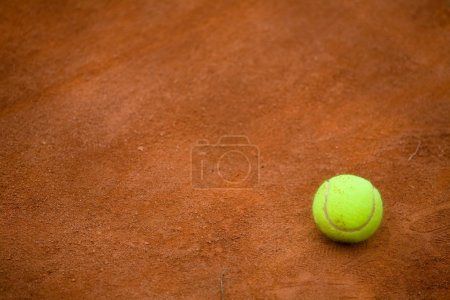 Clay tennis court and tennisball