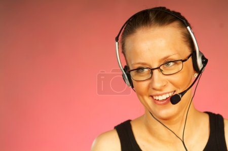 Young pretty woman wearing a phone headset.