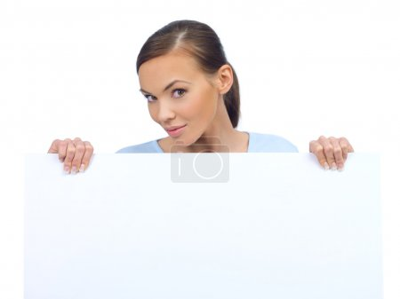 Cute woman holding an empty white board