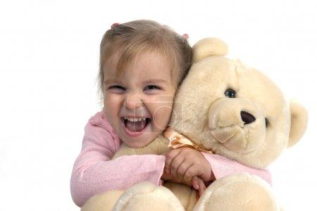 Cheerful girl with bear
