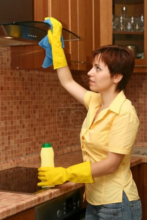 Photo for Girl on kitchen wipes technics - Royalty Free Image