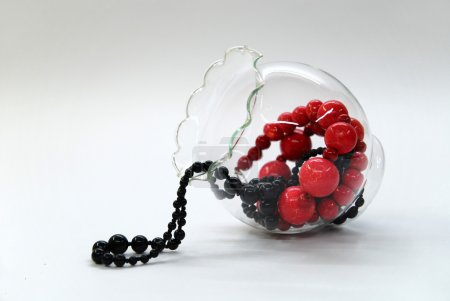 Red and black beads in a glass bowl