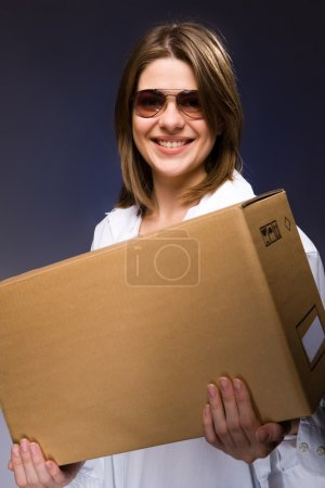 Photo for Woman courier with big box - Royalty Free Image