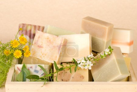 Photo for Group of handmade soap in wooden box, nature material. - Royalty Free Image