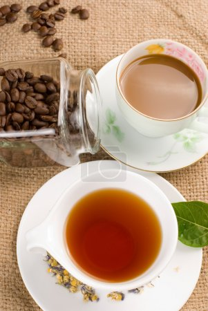 Photo for Coffee, coffee beans and tea with green leaf - Royalty Free Image