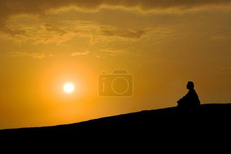 Photo for Meditation under sunset, Buddhist activity - Royalty Free Image