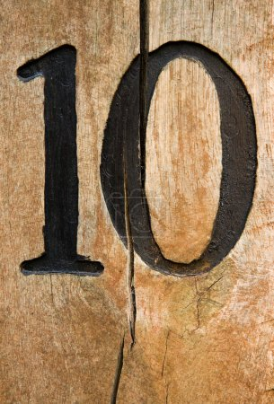 Number ten on cracked wood