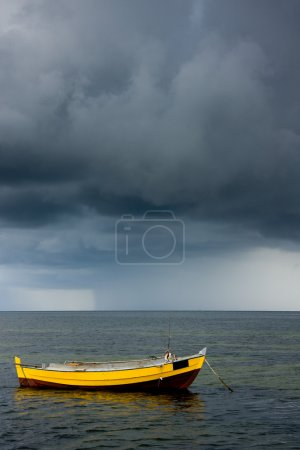 Fishing boat and stormy sky