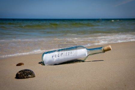 Photo for Help message in the bottle on a sea shore - Royalty Free Image