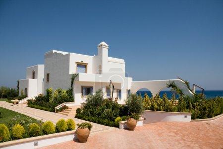 Luxury white house over sea
