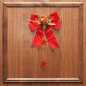 Red christmas bow on a wood