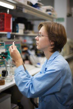 Scientist with syringe