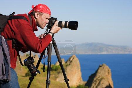 Photographer,tripod,sea,rocks