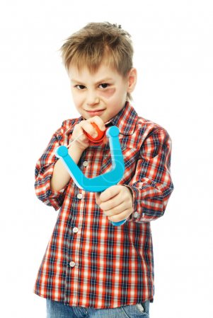 Little boy with a slingshot
