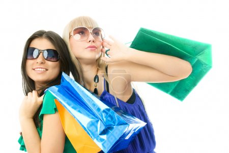 Photo for Portrait of two young beautiful women with shopping bags - Royalty Free Image
