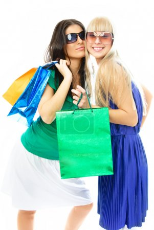 Photo for Two beautiful young women with shopping bags against white background - Royalty Free Image