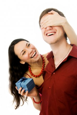 Photo for Cheerful beautiful brunette woman gives a present to her husband - Royalty Free Image
