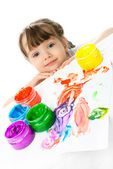 Little girl painting with finger paints