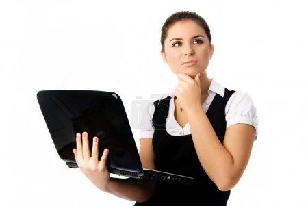 Thoughtful woman with a laptop