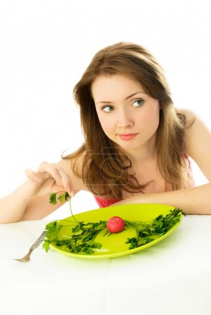 Unhappy woman keeping a diet
