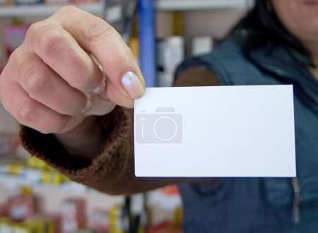 Woman holding blank visit card