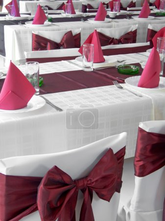 Photo for Nice red wedding table set with arranged silverware and napkins - Royalty Free Image